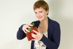 Studio portrait of young woman holding gift box Royalty Free Stock Photo