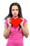Studio portrait of a young woman holding a heart Royalty Free Stock Image