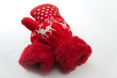 Baby winter clothes wool red mittens white background. Studio quality white background red wool mittens baby winter clothes bear Santa Claus Christmas gift stock image