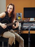 In the studio recording guitar tracks Stock Images
