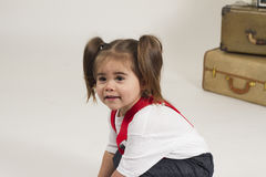 Studio sales girl. Young girl plays dressup in the studio Stock Images