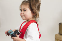 Studio sales girl. Young girl plays dressup in the studio Stock Image