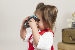 Studio sales girl. Young girl plays dressup in the studio Royalty Free Stock Photo