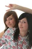 Studio schoss von zwei modischen jugendlich Mädchen Stockbild