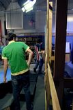 Studio set. Two film students working on building a new studio production set on the stage Stock Photo