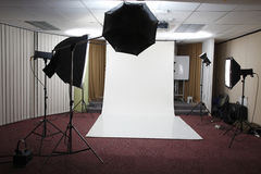 Studio setting. Setting up a studio from an office stock photo