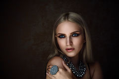 Studio shoot of blonde woman with jewelry. Fashion portrait. royalty free stock images