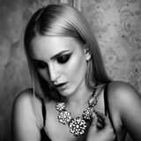 Studio shoot of  blonde woman with jewelry. Fashion portrait. Black and white Stock Photography