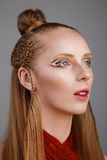 Studio shoot of futuristic woman with creative make-up and hairs Royalty Free Stock Photography
