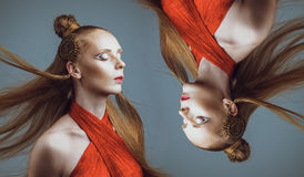 Studio shoot of futuristic woman with creative make-up and hairs Stock Photo