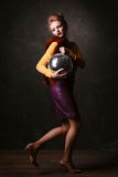 Studio shoot of posing woman holding disco ball.  Retro style. Royalty Free Stock Photo