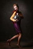 Studio shoot of posing woman holding disco ball.  Retro style. Royalty Free Stock Photo