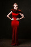Studio shoot of posing woman in long red dress. Retro style. Stock Photography