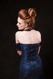 Studio shoot of posing woman in sexy blue dress. Retro style. Cr Royalty Free Stock Photos