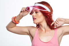 Studio shoot of a summer woman wearing pink plastic  cap Royalty Free Stock Images
