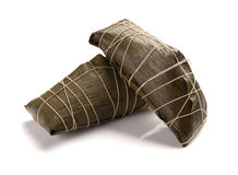 Studio shoot of two wrapped Chinese ZongZi on white for Dragon Boat Festival Stock Photo