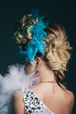 Studio shoot of woman with creative hairstyle, makeup and dress. Stock Photography