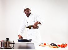 Chef Cooking In His Kitchen royalty free stock image