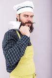 Studio shot of an angry bearded man holding a butcher knife Royalty Free Stock Image