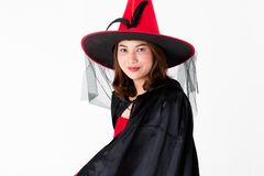Studio shot Asian woman in red dress costume for famale witch lo stock photos