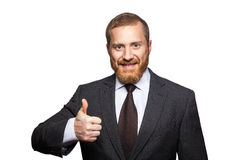 Studio shot of attractive businessman. Happy businessman showing thumbs up, looking at camera Stock Photos