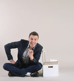 Studio shot of attractive positive businessman with office stuff Stock Image