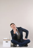 Studio shot of attractive positive thinking businessman with off Royalty Free Stock Image