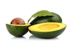 Studio shot of avocado with leaf and pit core isolated Royalty Free Stock Image