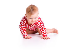 Studio shot of baby crawling Royalty Free Stock Photos