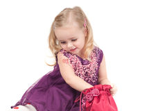 Studio shot of baby girl in gala dress Royalty Free Stock Image