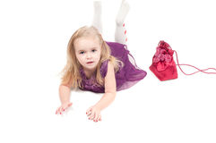 Studio shot of baby girl in gala dress Stock Image