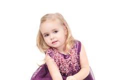 Studio shot of baby girl in gala dress Stock Image