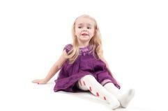 Studio shot of baby girl in gala dress Royalty Free Stock Image