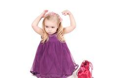 Studio shot of baby girl in gala dress Stock Photos