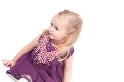 Studio shot of baby girl in gala dress Royalty Free Stock Photos