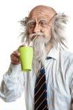 Studio shot of bald elegant oldman with cup Stock Photo