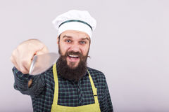 Studio shot of a bearded man holding a big sharp knife Stock Photography