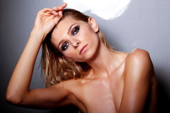 Studio shot of beautiful naked female. Portrait of beautiful girl with wet hair and glamour makeup Stock Photography