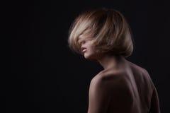 Studio shot of beautiful young blond woman Stock Photography