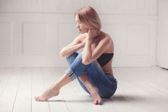 Studio shot of beautiful young blond woman Stock Images