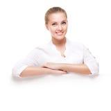 Studio shot of beautiful young smiling woman Stock Photos