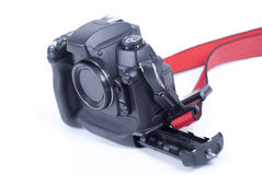 Studio shot of black digital SLR camera on white Royalty Free Stock Images