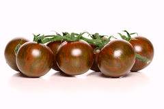Studio shot of black tomatoes Royalty Free Stock Photography