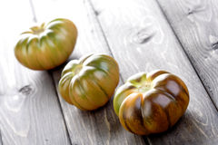 Studio shot of black tomatoes on white bacground Royalty Free Stock Photos