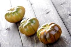 Studio shot of black tomatoes on white bacground Royalty Free Stock Photos