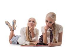 Studio shot of blond schoolgirls posing at camera Stock Photo