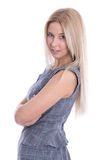 Studio shot of blond successful woman in dress with arms crossed Stock Photography