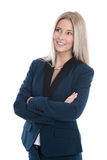 Studio shot of blond woman in suit with arms crossed isolated on Stock Image