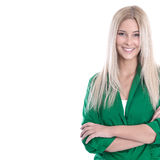 Studio shot of blond young woman with arms crossed isolated on w Royalty Free Stock Photo
