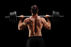 Studio shot of a bodybuilder lifting a barbell Stock Images